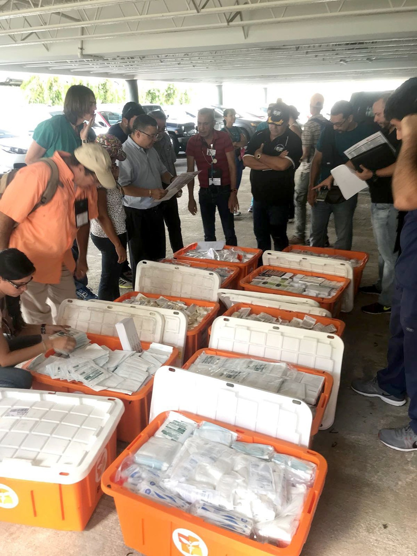 Doctors and nurses meet with Direct Relief staff Friday morning in San Juan, Puerto Rico to stock up on emergency supplies. Direct Relief provided staff with Emergency Health Kits, which contain basic medicines and first aid supplies, which equipped the healthcare providers as they traveled to 15 different towns across Puerto Rico to provide medical care. (Gordon Willcock/Direct Relief) (PRNewsfoto/Direct Relief)