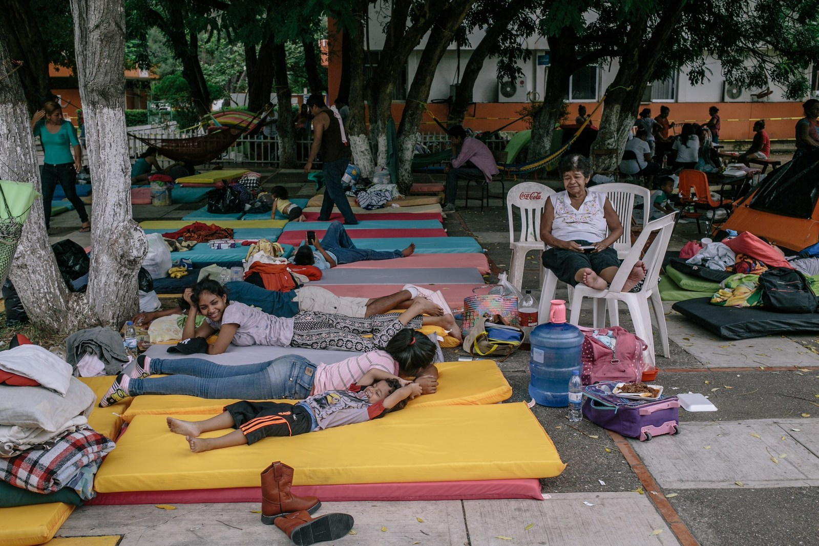 Families that lost their homes in the earthquake rest on mattress pads provided at a government-run shelter in Juchitan, Mexico. (Photo by Meghan Dhaliwal for Direct Relief)