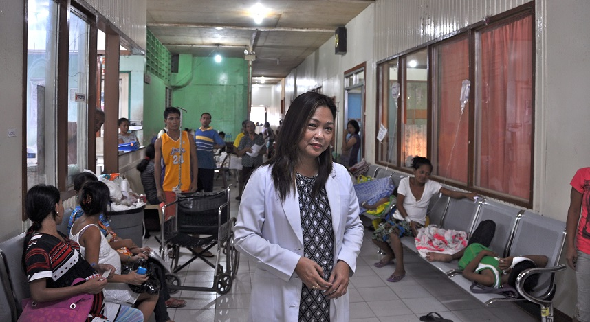 One year after Typhoon Haiyan, Dr. Maria stands in the corridor of Ormoc District Hospital in the Philippines where survivors are seeking care after much of the country's health system was destroyed.