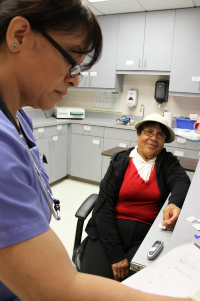 A patient receives treatment at the Dr. Virgil Gianellli Medical Clinic. Photo courtesy of St. Mary's Dining Room.