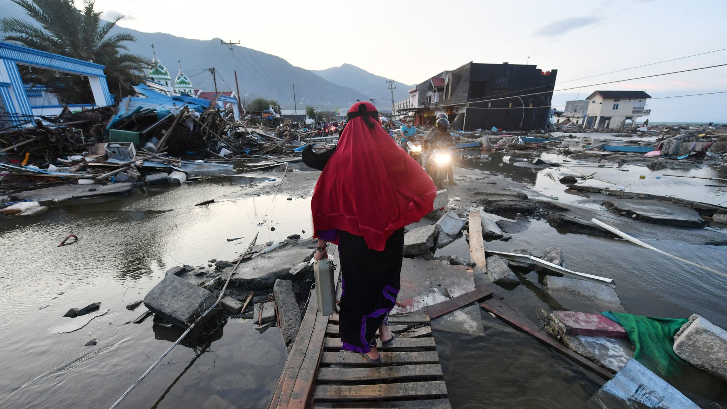 A woman walks through a devastated area in Palu, Indonesia's Central Sulawesi on October 1, 2018, after an earthquake and tsunami hit the area on September 28.      (Adek Berry/AFP/Getty Images)