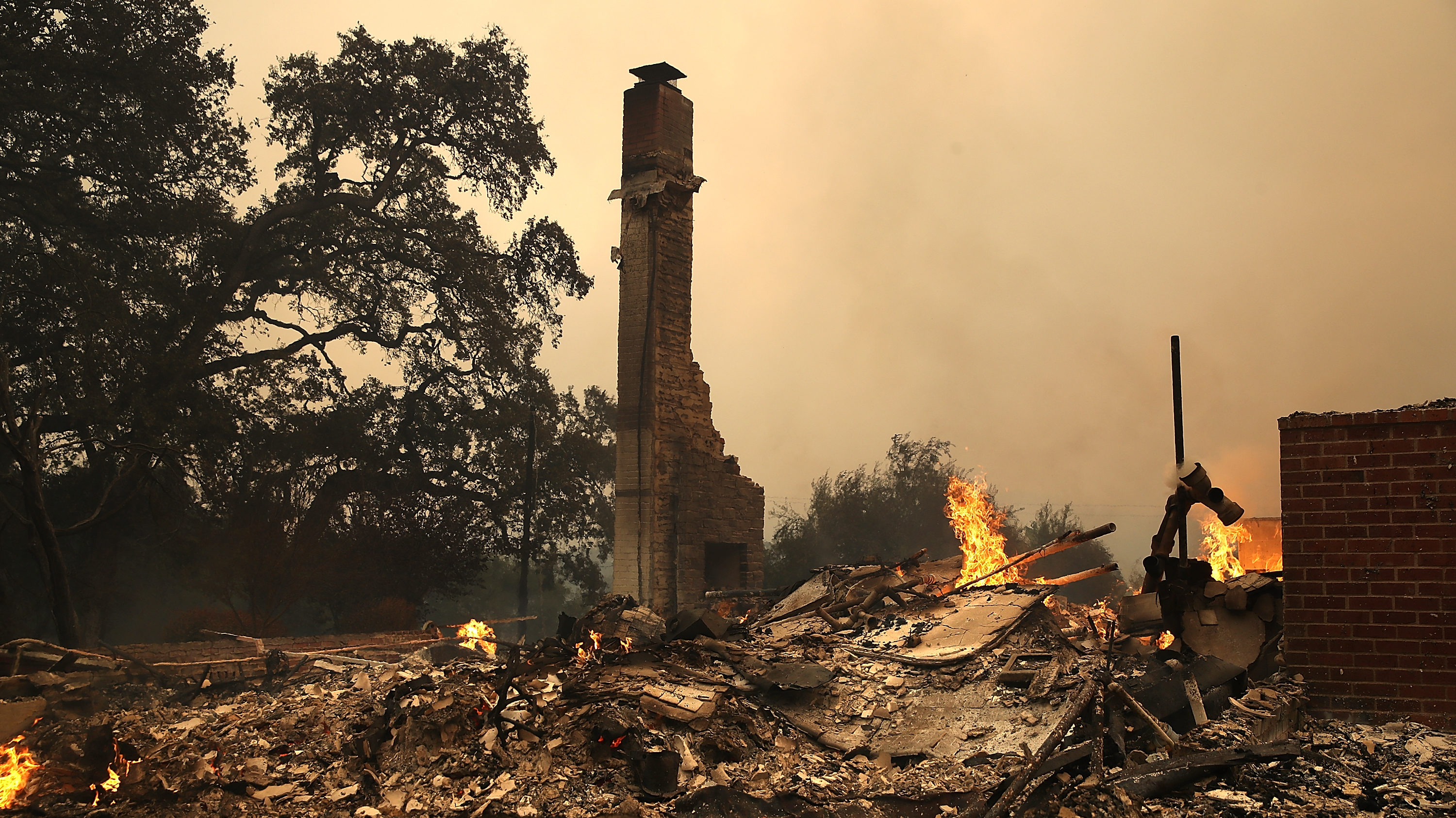 GLEN ELLEN, CA - OCTOBER 09:  The remains of fire damaged homes after an out of control wildfire moved through the area on October 9, 2017 in Glen Ellen, California. Tens of thousands of acres and dozens of homes and businesses have burned in widespread wildfires that are burning in Napa and Sonoma counties.  (Photo by Justin Sullivan/Getty Images)