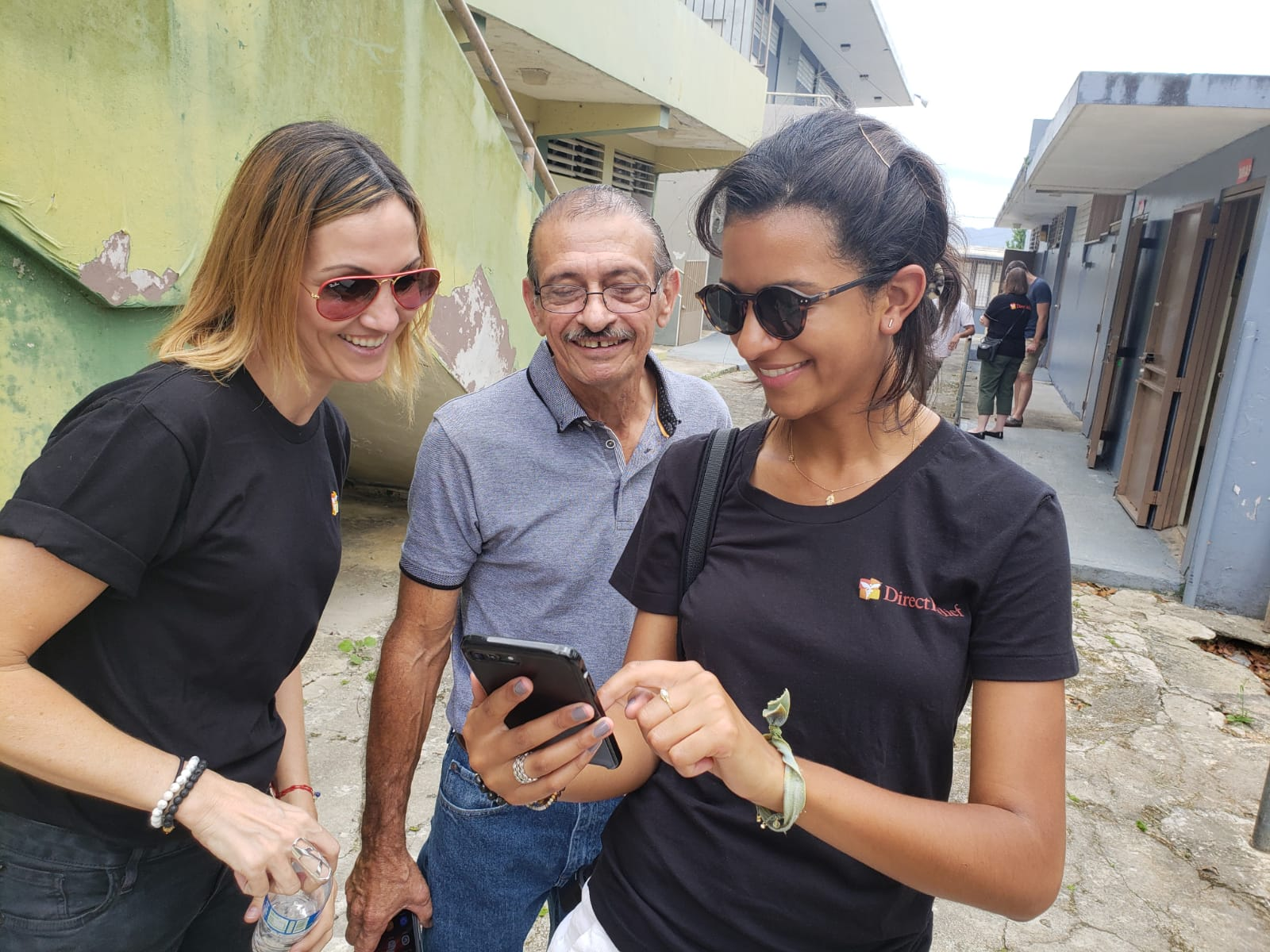 Direct Relief's Bryn Blanks and Ivonne Rodriguez navigate Facebook's Crisis Response tools with Utuado community leader, Miguel Morales. (Andrew Maccalla/Direct Relief)