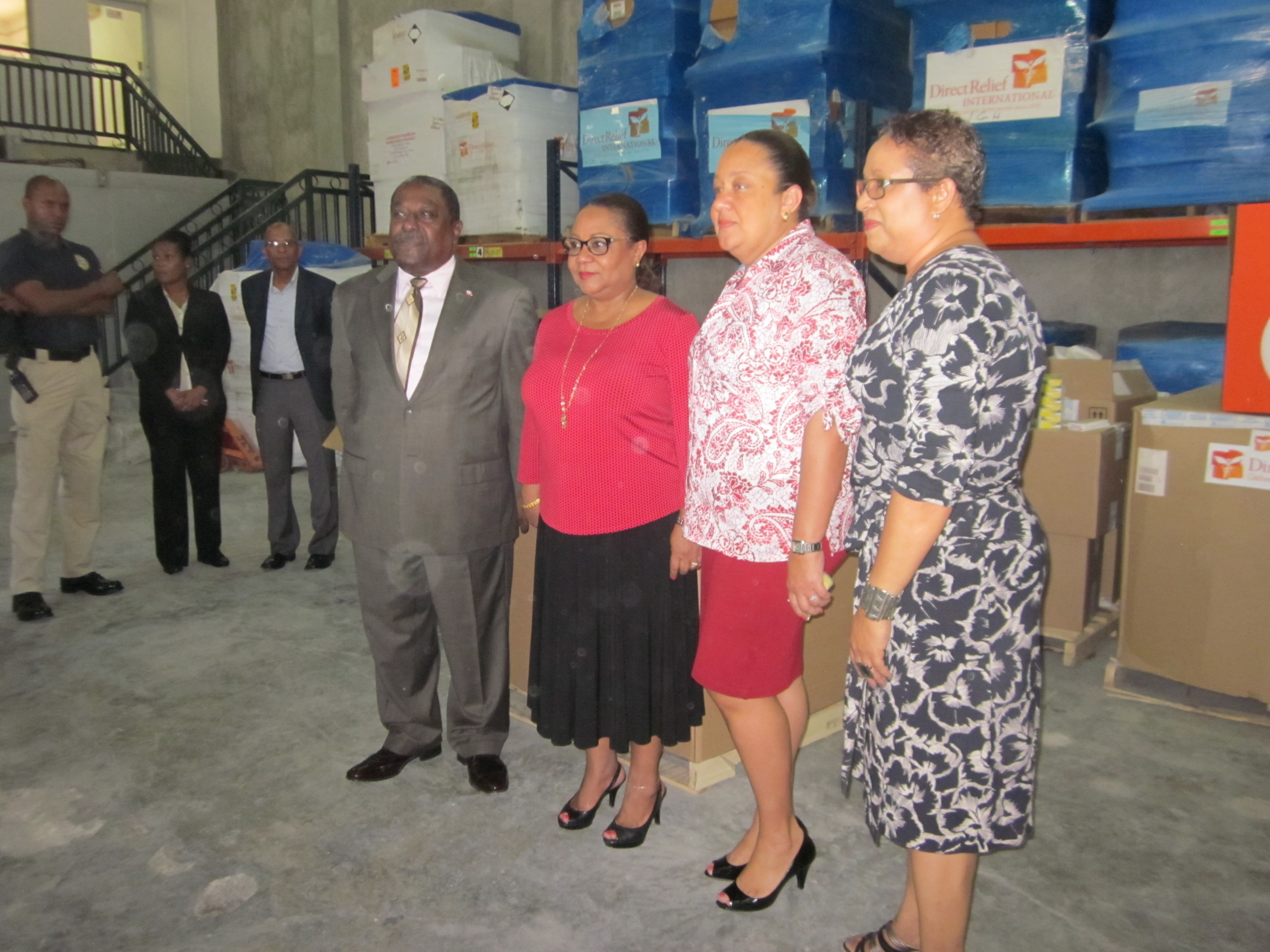Haitian First Lady Sophia Martelly (second from left) and Health Minister Florence Duperval Guillaume (second from right) today announced the distribution of chikungunya treatment kits at Direct Relief's warehouse in Haiti.