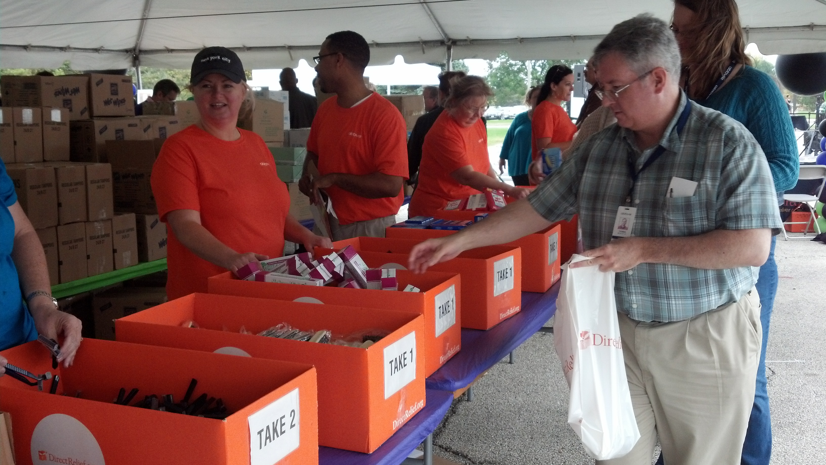 Employees helping pack family emergency kits at AbbVie's workplace giving campaign kick-off.