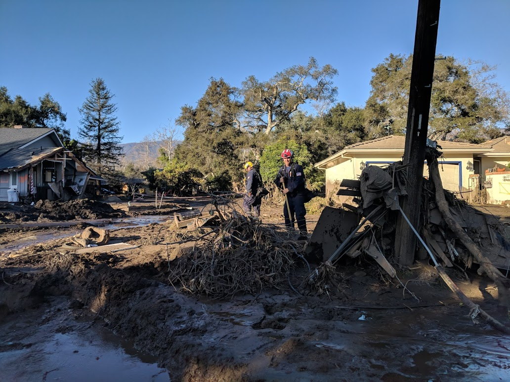 First responders dig through debris in Montecito on Jan. 11, 2018. Santa Barbara County Public Health officials are urging the public to take precautions to protect against disease. (Tony Morain/Direct Relief)