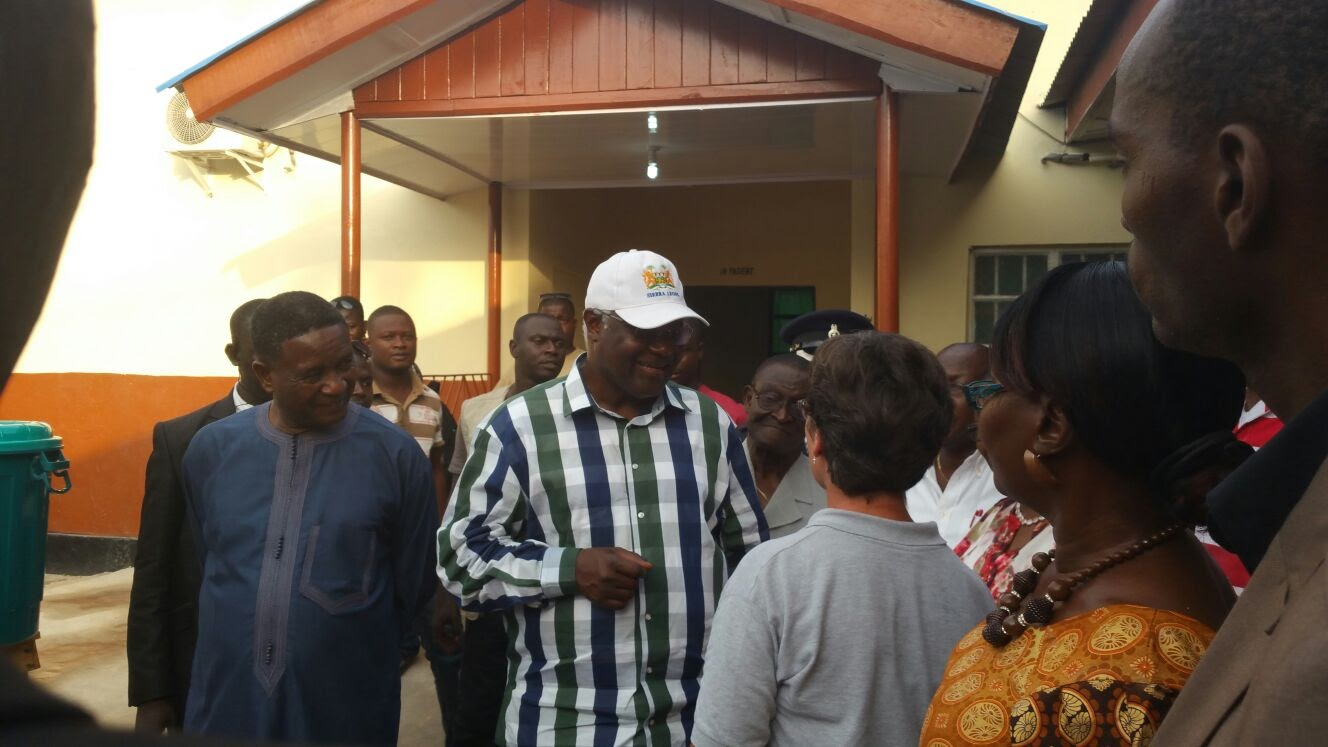 Sierra Leone's President visits Survivor's Clinic where two babies are born to Ebola Survivors