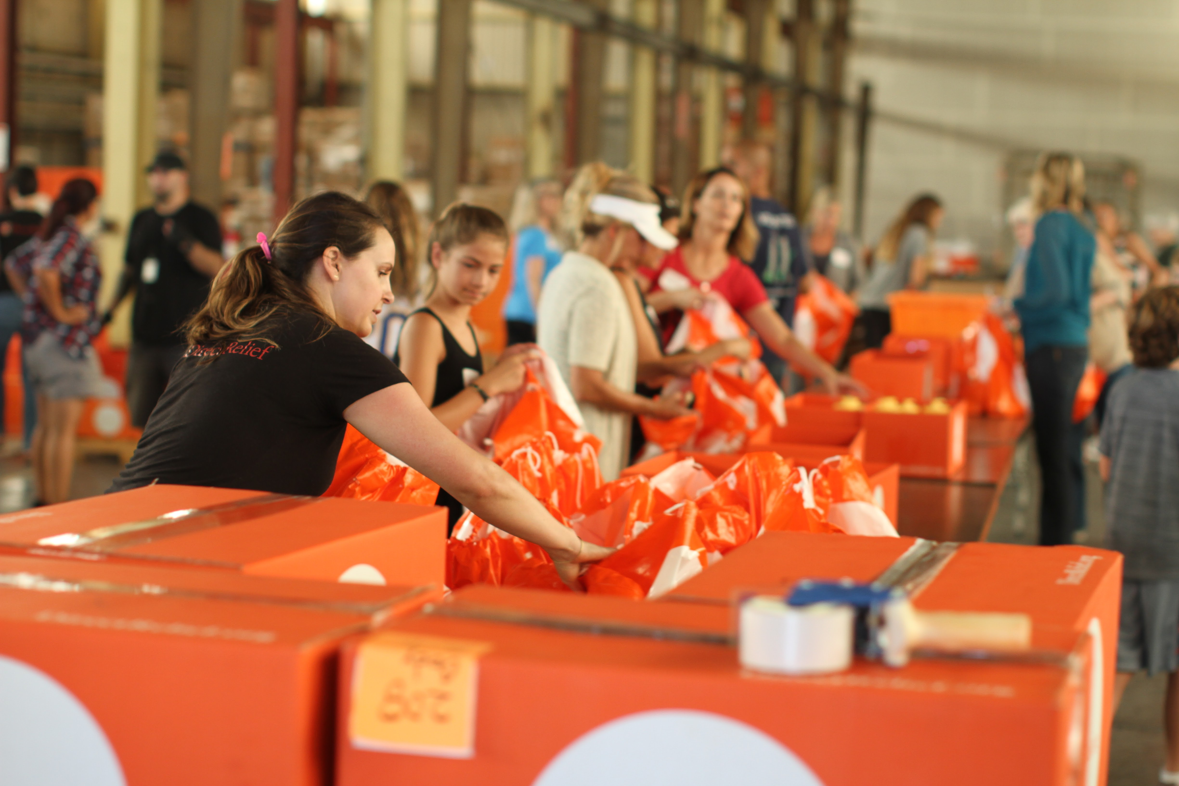 Direct Relief staff and volunteers working in warehouse