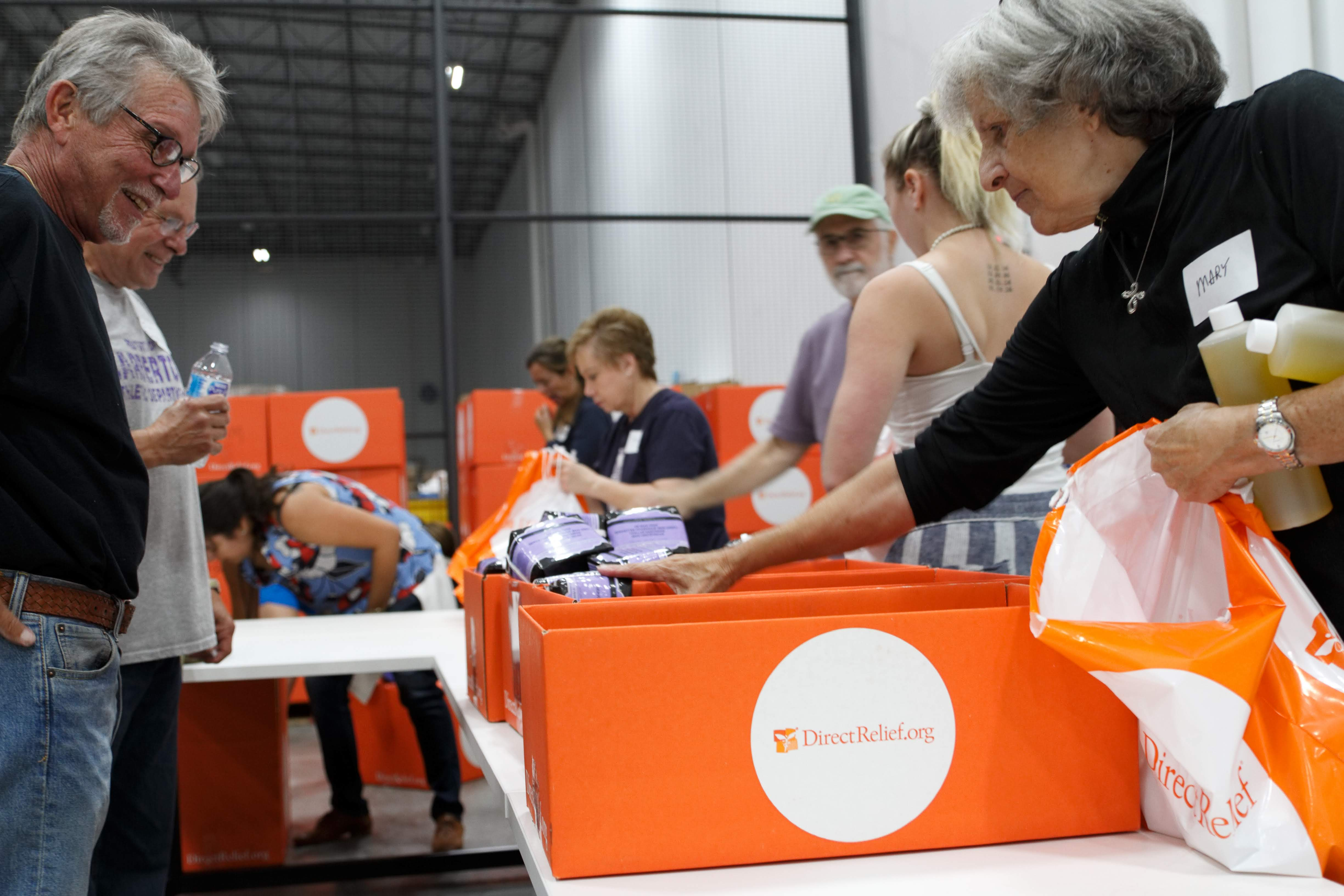Volunteers pack up hygiene items like soap and shampoo at Direct Relief headquarters last week for people displaced from their homes after Hurricane Florence. Many people are still living in shelters since floodwaters swept through their communities. (Andrew Fletcher/Direct Relief)