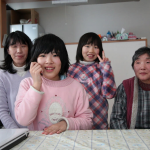 12-year-old Haruka (front) and her family were able to relocate with help from Japan Relief and Recovery Funds. Photo courtesy of the Association for Aid and Relief, Japan.