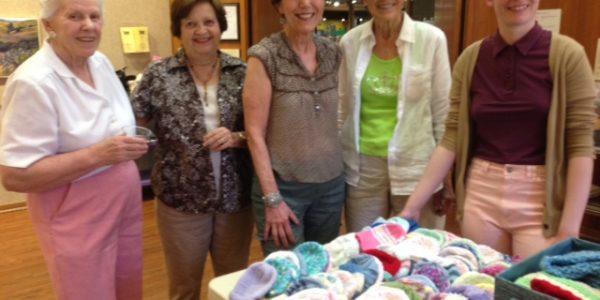 Local Club Knits 1,000 Hats for Newborns Worldwide