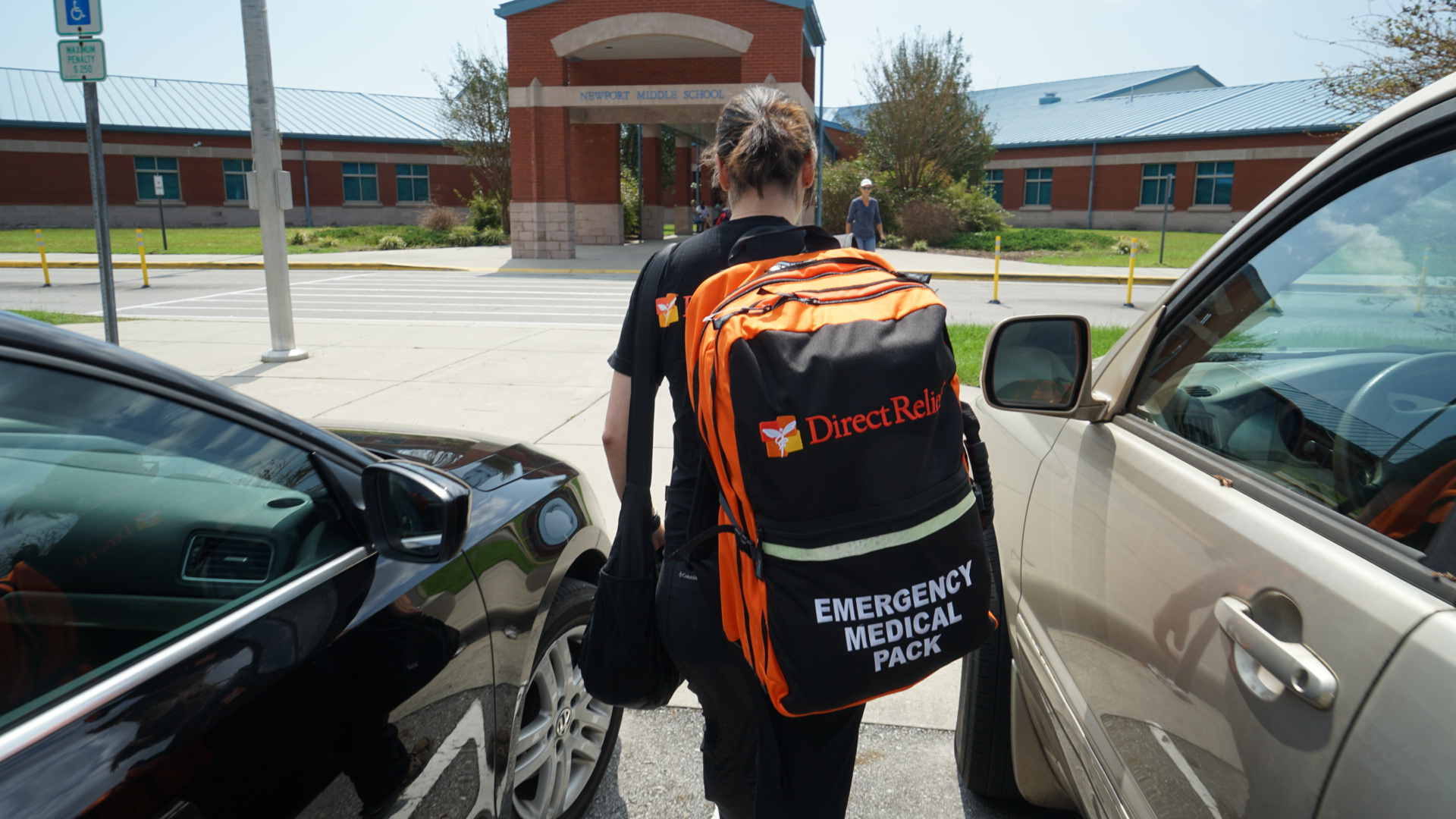 Direct Relief staff deliver emergency medical backpacks Saturday, Sept. 22, 2018, to a shelter operating out of a middle school in Newport, North Carolina. The shelter housed more than 400 people after Hurricane Florence made landfall, and health staff there used Direct Relief-provided medical supplies to treat an influx of patients after many were evacuated from their homes in the wake of rising floodwaters. (Lara Cooper/Direct Relief)