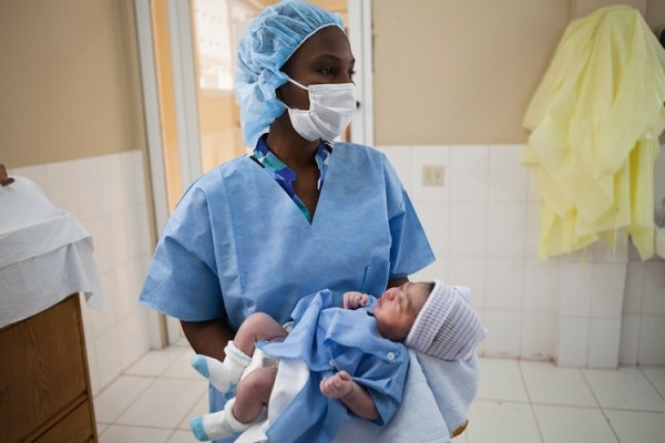 A nurse holds a new baby born at Haiti Hospital Appeal's maternity ward. Courtesy photo.