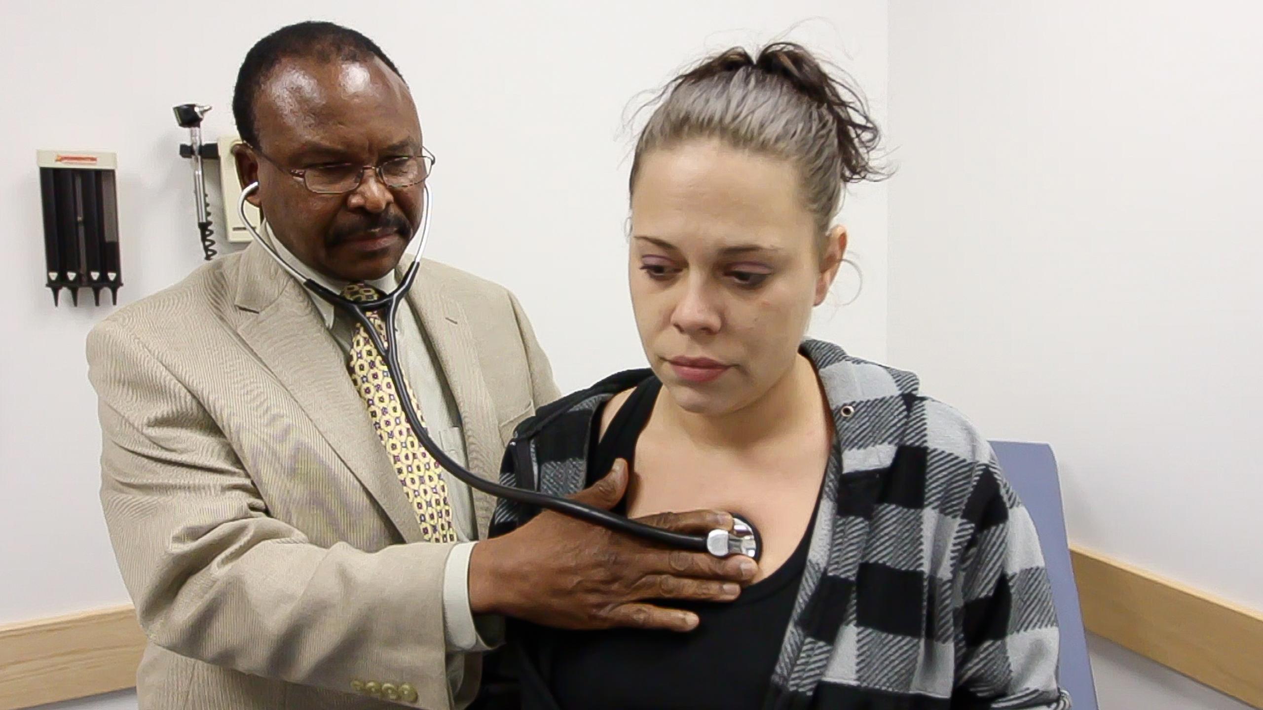 Dr. Ochuba of the Charles Drew Health Center treats a patient. Courtesy photo.