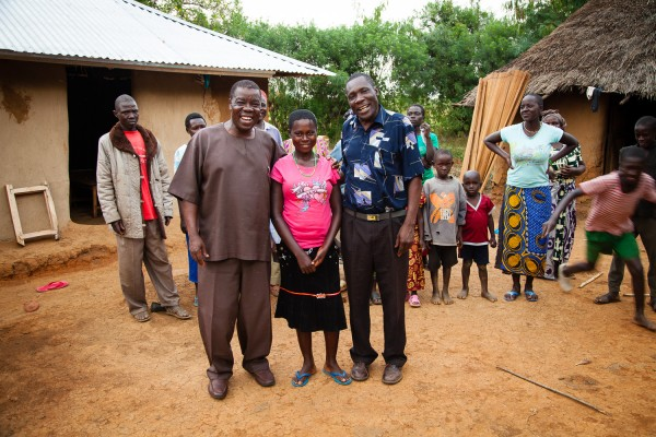 Dr. John Mbogo and Clinical Officer Sylvester Alouch visit with their patient, Phoebe, back home in her community in Siaya District, Kenya, following her successful fistula repair.