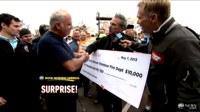 Direct Relief President and CEO, Thomas Tighe, presents a check to the Point Breeze Volunteer Fire Department.