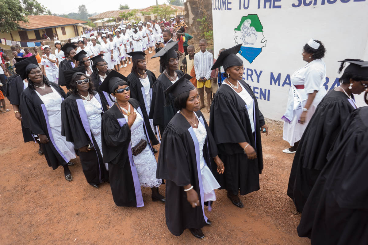 Processional of graduates and students entering the ceremony.
