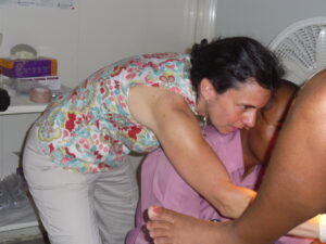 Dr. Rachel Masch from Basic Health International trains a Haitian provider
