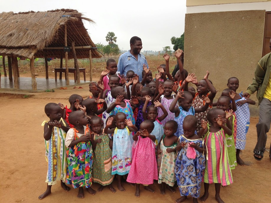 Dr. Joseph Dumba, of the Healing Kadi Foundation, stands with children in Kajo Keji in South Sudan in 2014. While the country has endured hardships of war and famine, Direct Relief has been active in supporting medical partners like the foundation in the area. Direct Relief recently shipped over $600,000 worth of supplies to the Healing Kadi Foundation, including wound care supplies, blood pressure medicines and other critical products.