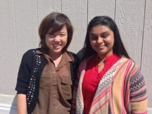 Lisa (left) and Shailja (right) smile outside of the IT trailer.