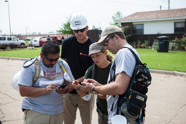 Andrew MacCalla (center) works with Team Rubicon on the ground in Moore, Okla. to conduct assessments and better help people in need.
