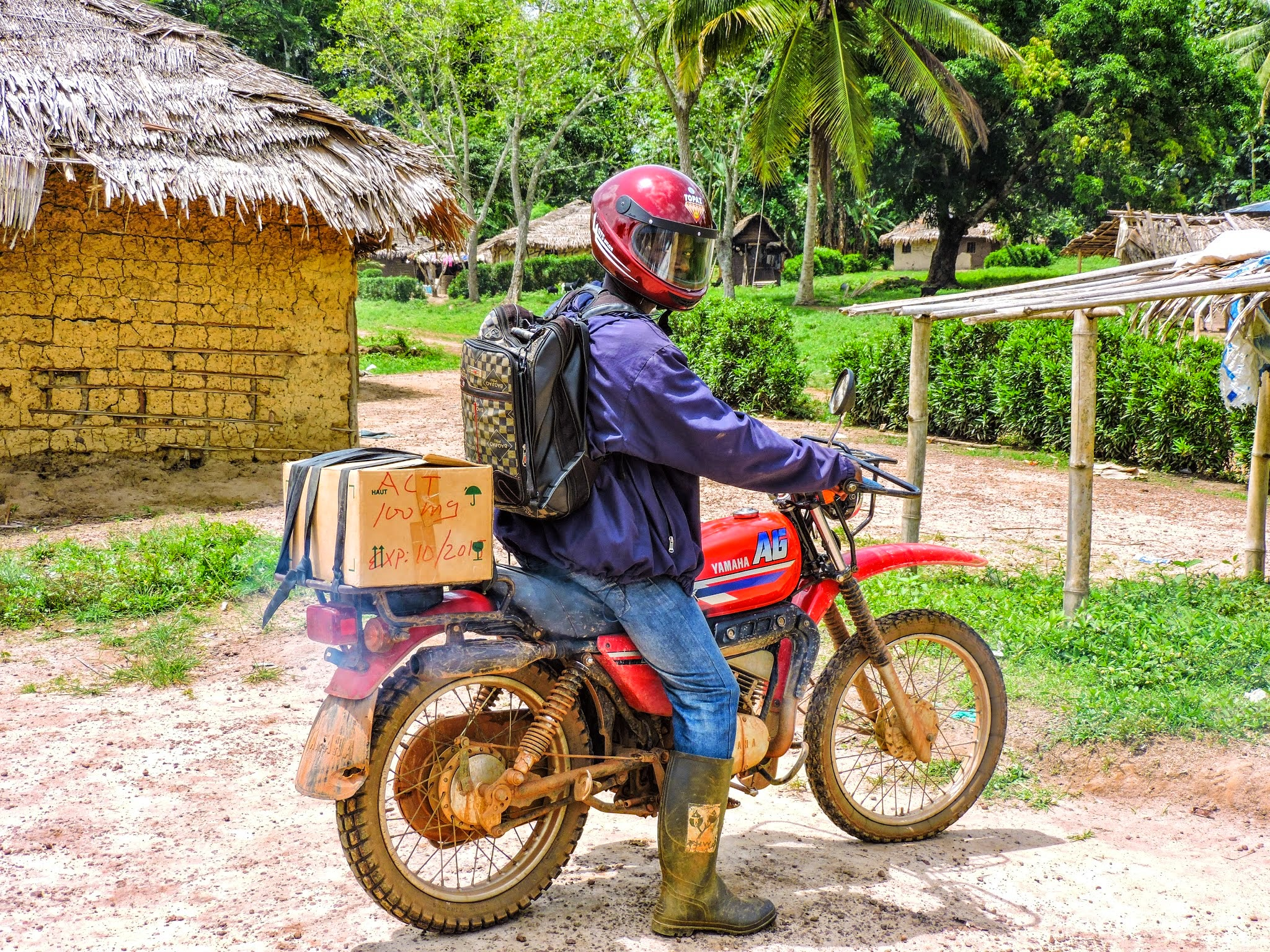 Theo, a frontline healthworker with Last Mile Health in Konobo, LIberia. Each day Theo and his colleagues travel hours by motorbike on treacherous roads to extend health care to people in Liberia's most difficult to reach villages.