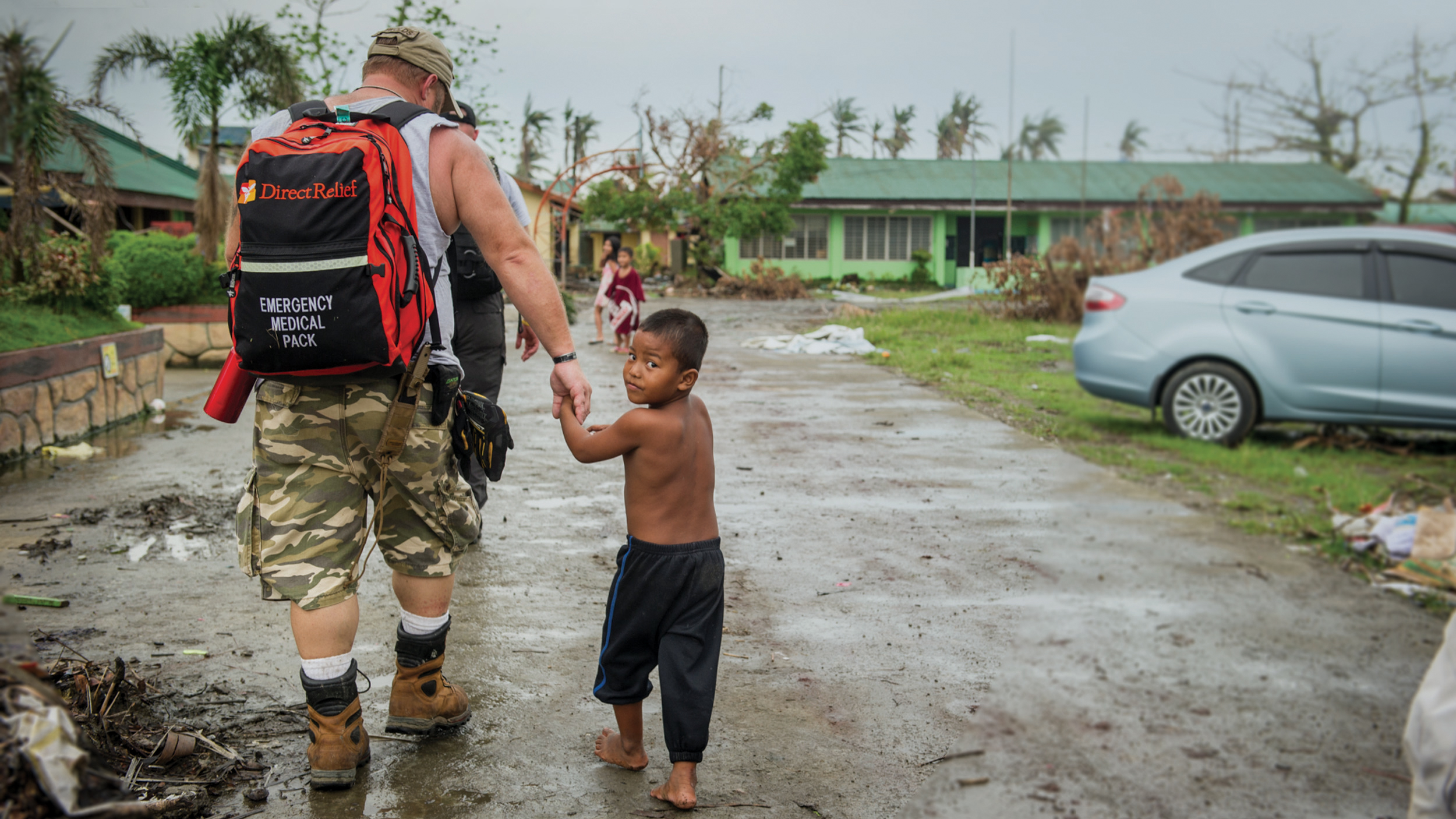 Emergency responder and child after Typhoon Haiyan