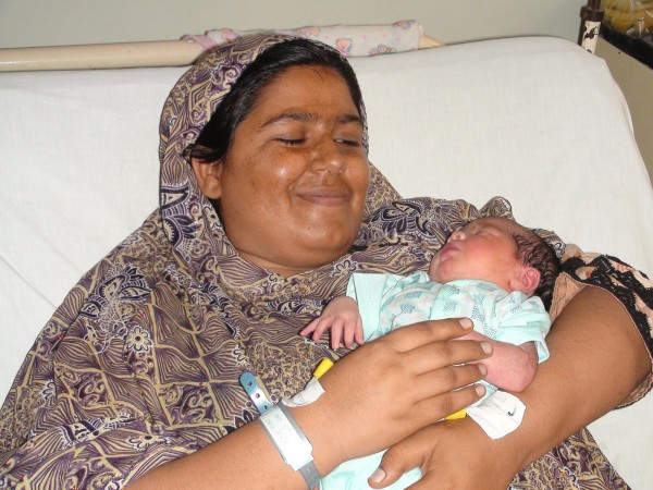 Wasila smiles with her baby. Photo courtesy of Murshid Hospital and Health Care Center.
