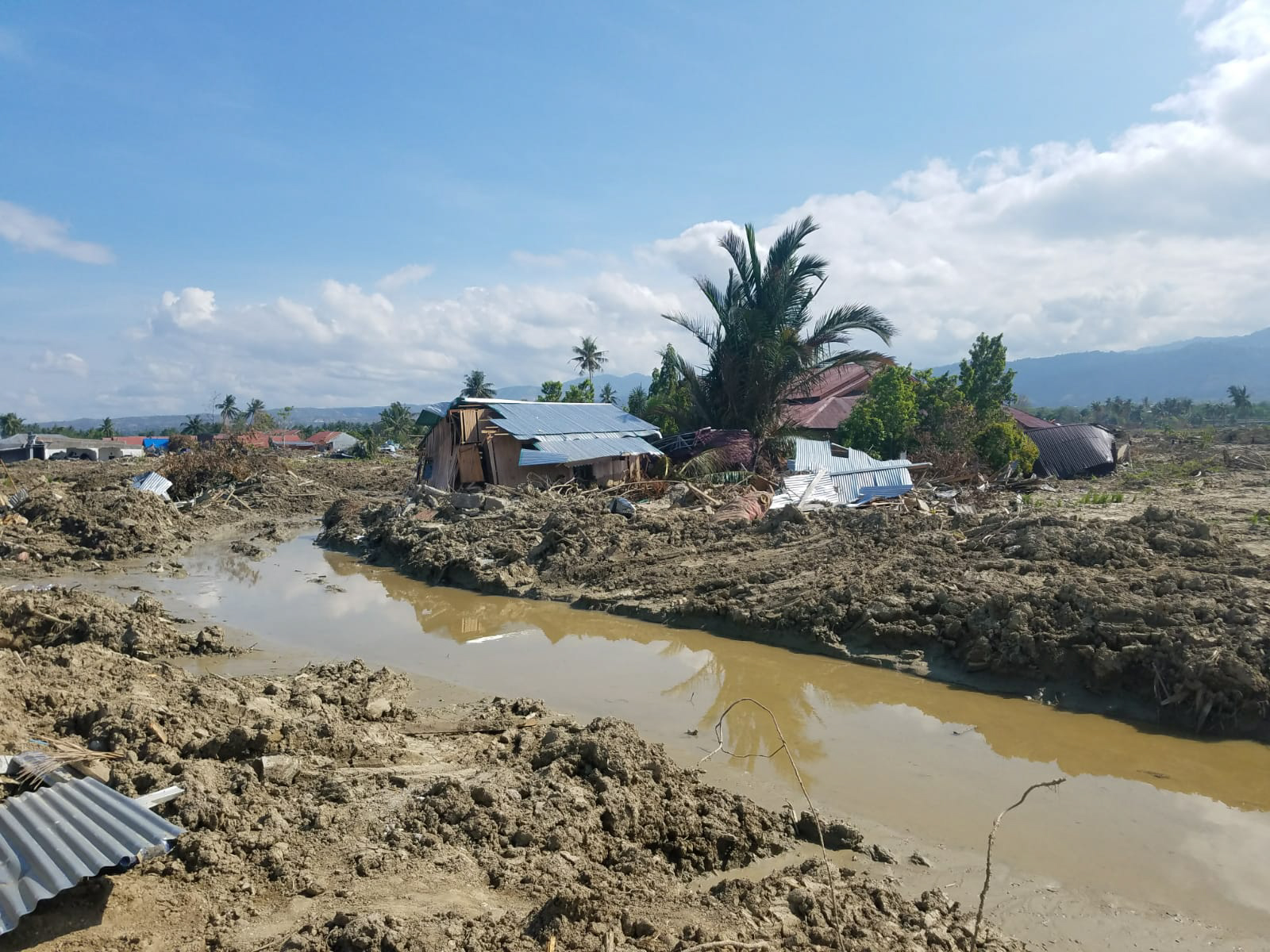 Devastation in Palu, Indonesia, is pictured on October 9, 2018. Responding in the area are members of the  Muhammadiyah Disaster Management Center, which has been conducting search and rescue in the days since the earthquake and tsunami struck, as well as medical outreach, shelter care and food distribution. Direct Relief is supporting MDMC with funding to continue their critical work in the region as recovery begins. (Photo courtesy of MDMC)