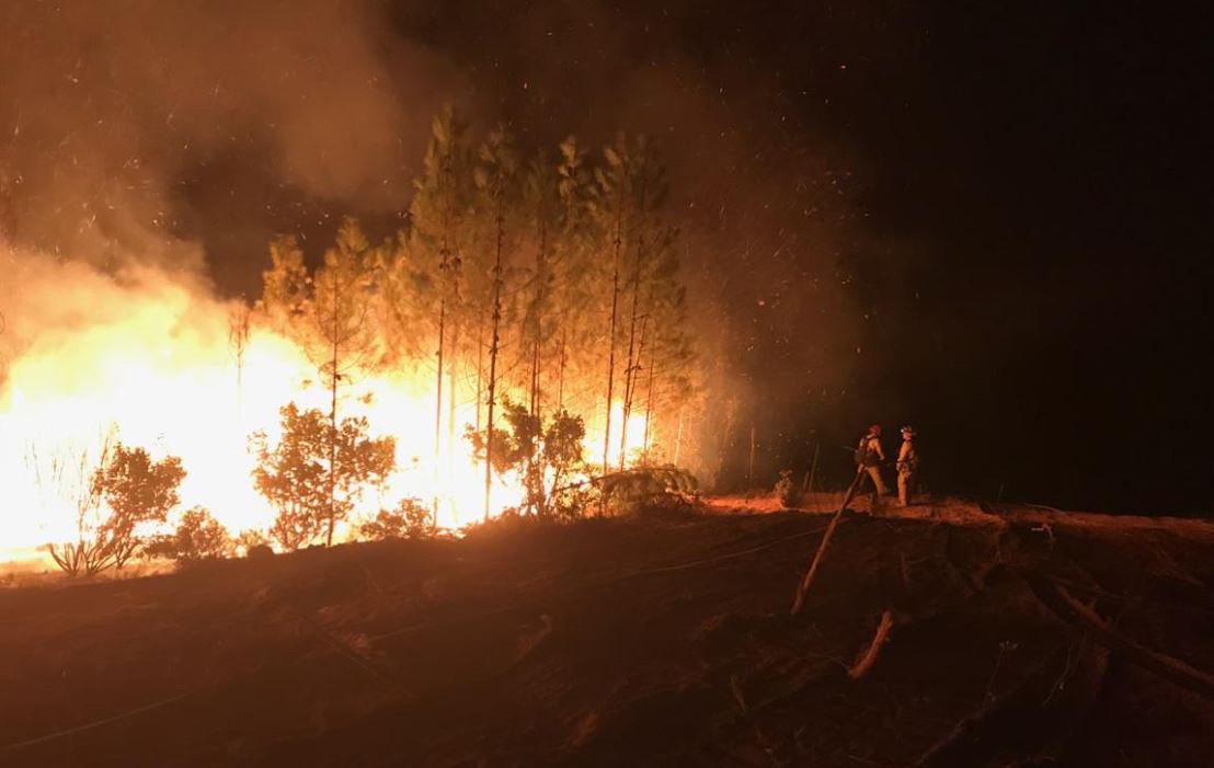 Firefighters battle the Carr Fire in Shasta County last week. Direct Relief is offering respiratory masks and other supplies to healthcare facilities in areas across the state impacted by fires. (Photo courtesy of the California Department of Forestry and Fire Protection)