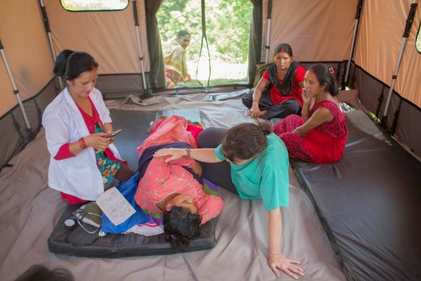 Nepal Midwives Attend to Pregnant Woman Credit: Castaneira