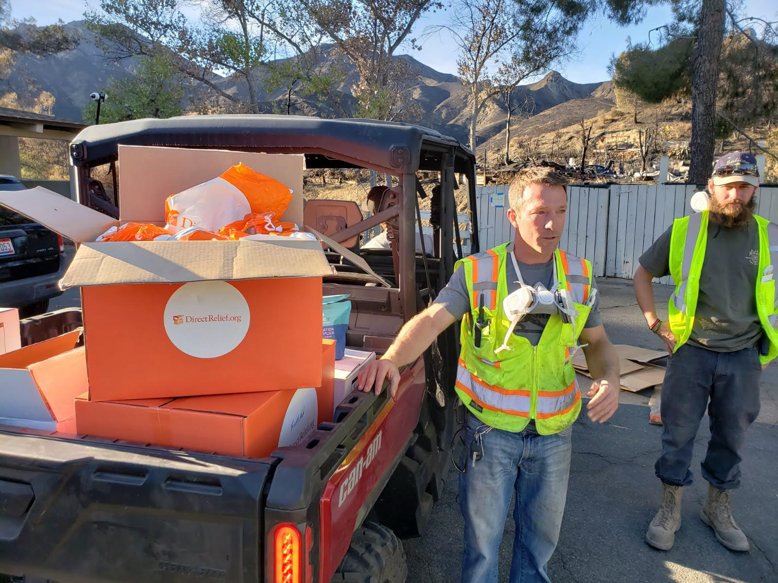 Direct Relief staff deliver medical aid to the Seminole Springs Mobile Home Park on Nov. 26, 2018, in Agoura Hills, California, where the Woolsey Fire ripped through earlier this month. Nearly half of the 215 homes in the Seminole Springs neighborhood burned, and the Upper Ojai Relief group has been assisting with recovery there. Direct Relief delivered protective gear for residents and volunteers, as well as N-95 respiratory masks, Direct Relief Medical Backpacks, and hygiene items for people who remain displaced. (Andrew MacCalla/Direct Relief)