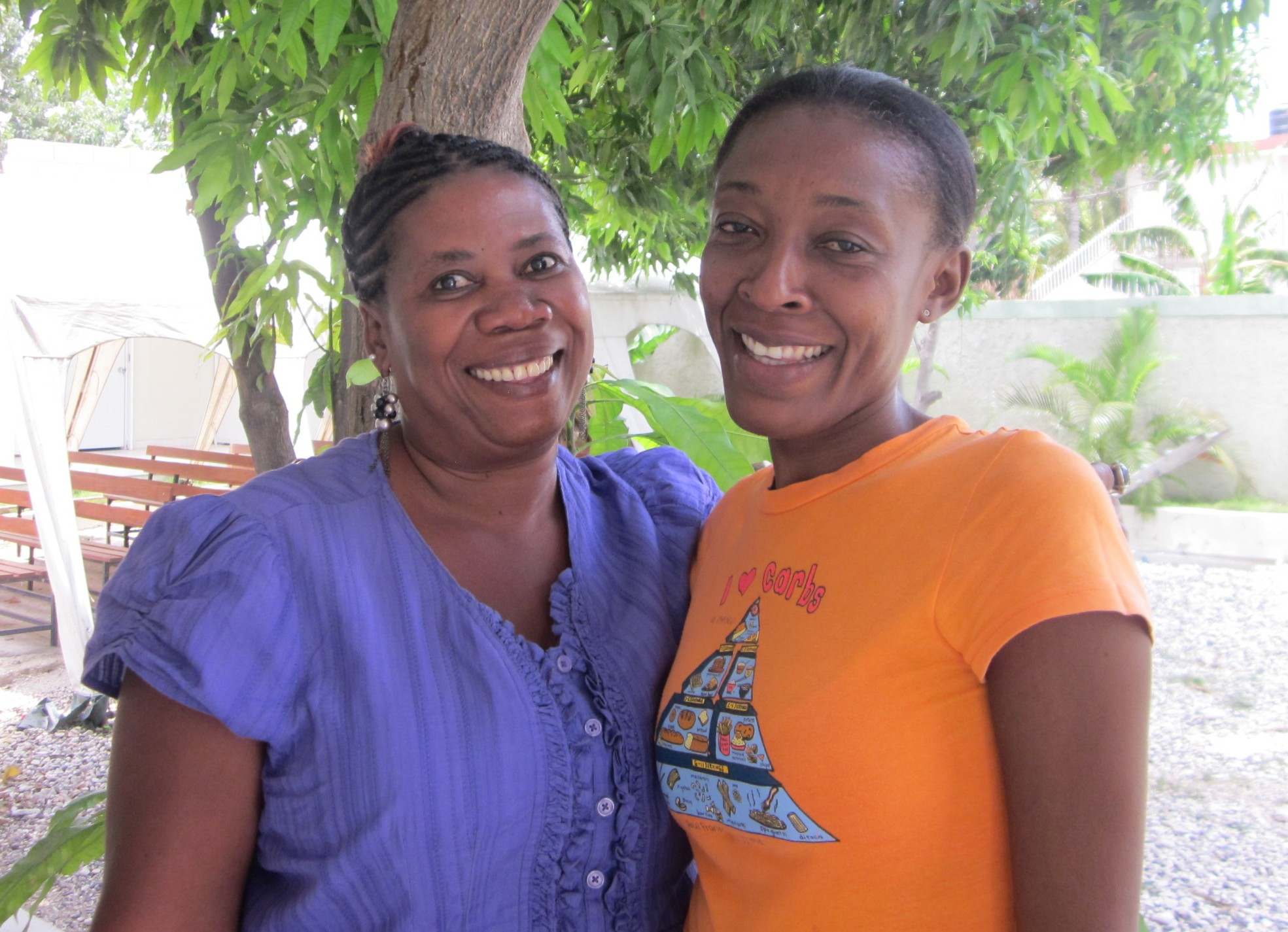 Yolette (left) and Adeline (right) help women access cervical cancer screenings in their community in Haiti.