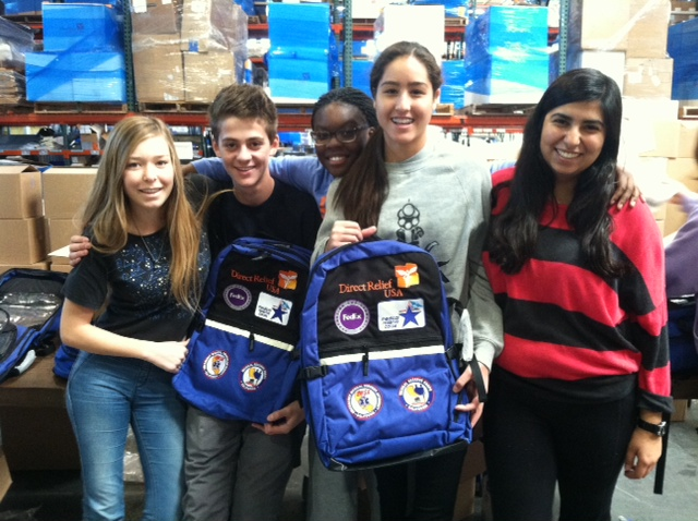 """Students from Cate School helped pack 500 MRC """"grab and go"""" backpacks at our warehouse on Tuesday."""