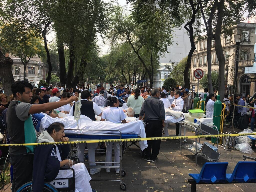 Patients evacuated from a nearby hospital wait in a park in the Mexico City neighborhood of Roma Norte Tuesday. (Courtesy photo)