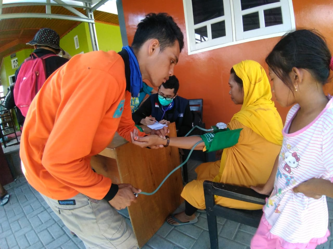 A Muhammadiyah volunteer measures the blood pressure of a woman seeking care at one of the organization's medical outposts set up in Palu, Indonesia, after last week's earthquake and tsunami. Muhammadiyah is one of the local groups Direct Relief is supporting. (Photo courtesy of Muhammadiyah)