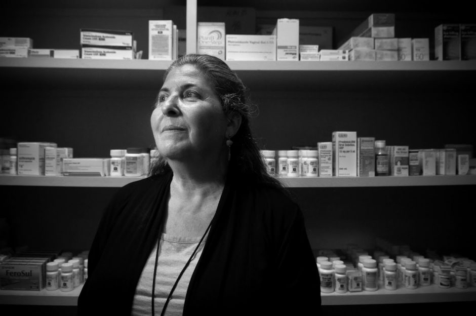 Janice Shea stands in the dispensary of the Goleta Neighborhood Clinic. Shea was once a frequent user of heroin, but has been clean for 33 years. She now works as a behavioral healthcare counselor at the clinic, working with substance abuse patients. The clinic where Shea works has received a critical donation of naloxone, an opioid overdose-reversing drug. (Lara Cooper/Direct Relief)