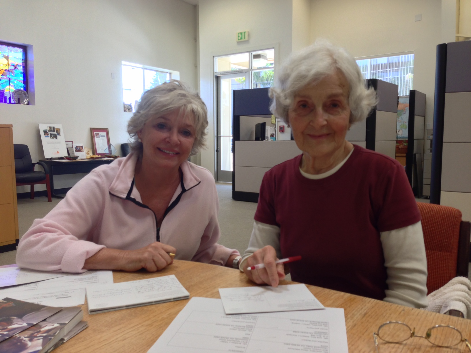 Ann (left) and Dolores (right) smile during a Tuesday morning letter-writing session.
