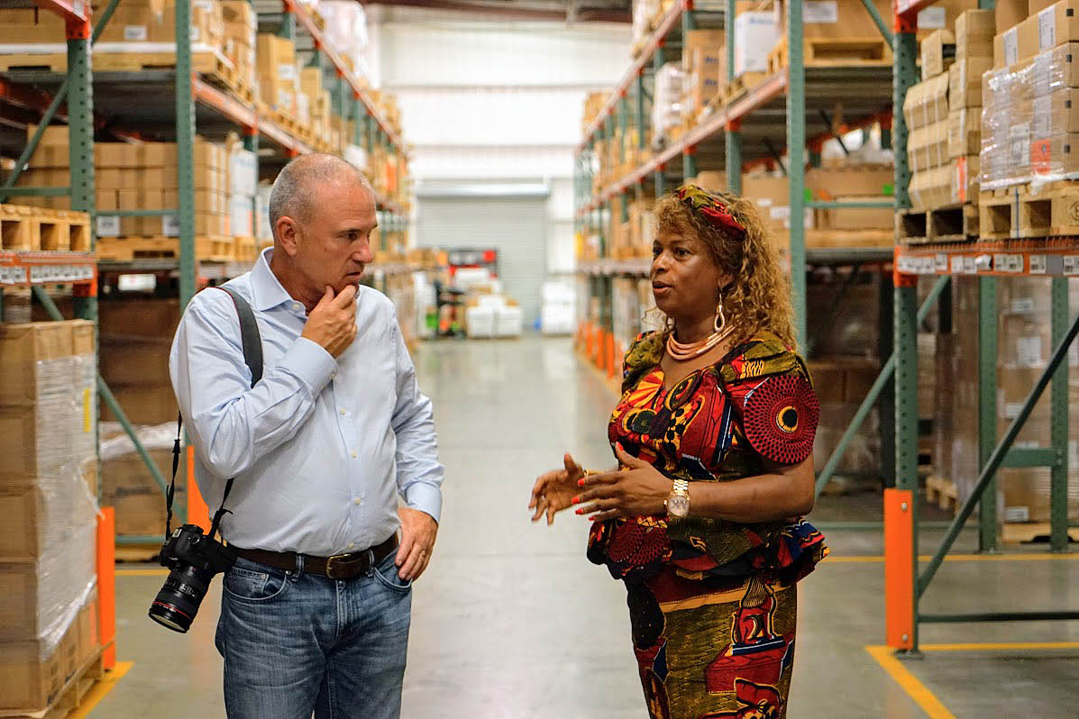 Direct Relief CEO Thomas Tighe hears from Sierra Leone's Honorary Consul Isatu Timbo on Aug. 18, 2017. Over 10,000 pounds of medical aid was shipped from Direct Relief's California warehouse to Sierra Leone in response to the deadly flooding in the country. (Tony Morain/Direct Relief photo)