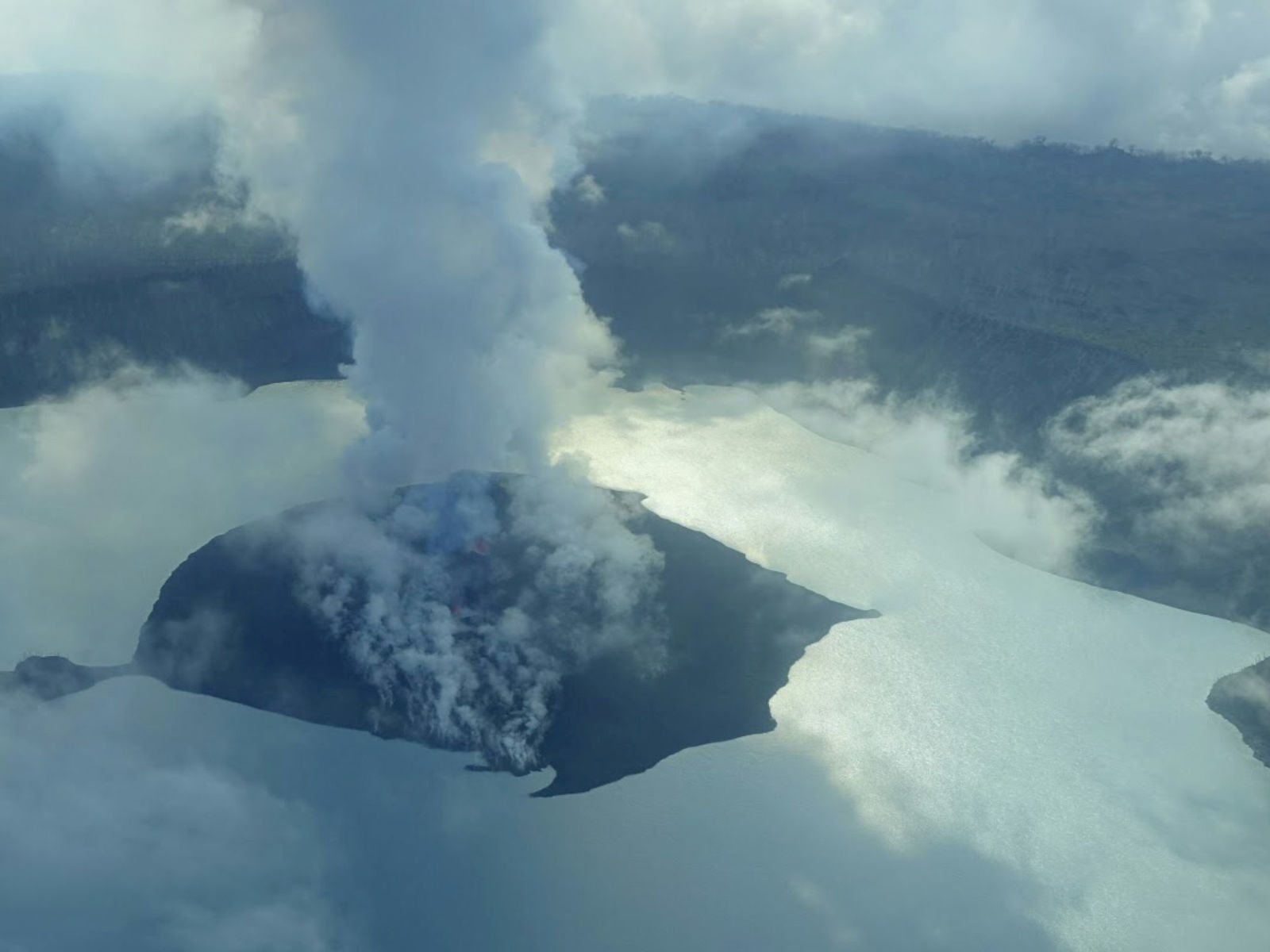 A cloud of smoke from Manaro Voui volcano is seen on Vanuatu's northern island Ambae in the South Pacific, September 25, 2017 in this aerial picture. COURTESY THOMAS BOYER, VOLCANOLOGIST via REUTERS THIS IMAGE HAS BEEN SUPPLIED BY A THIRD PARTY. MANDATORY CREDIT. NO RESALES. NO ARCHIVES - RC1374EF90A0