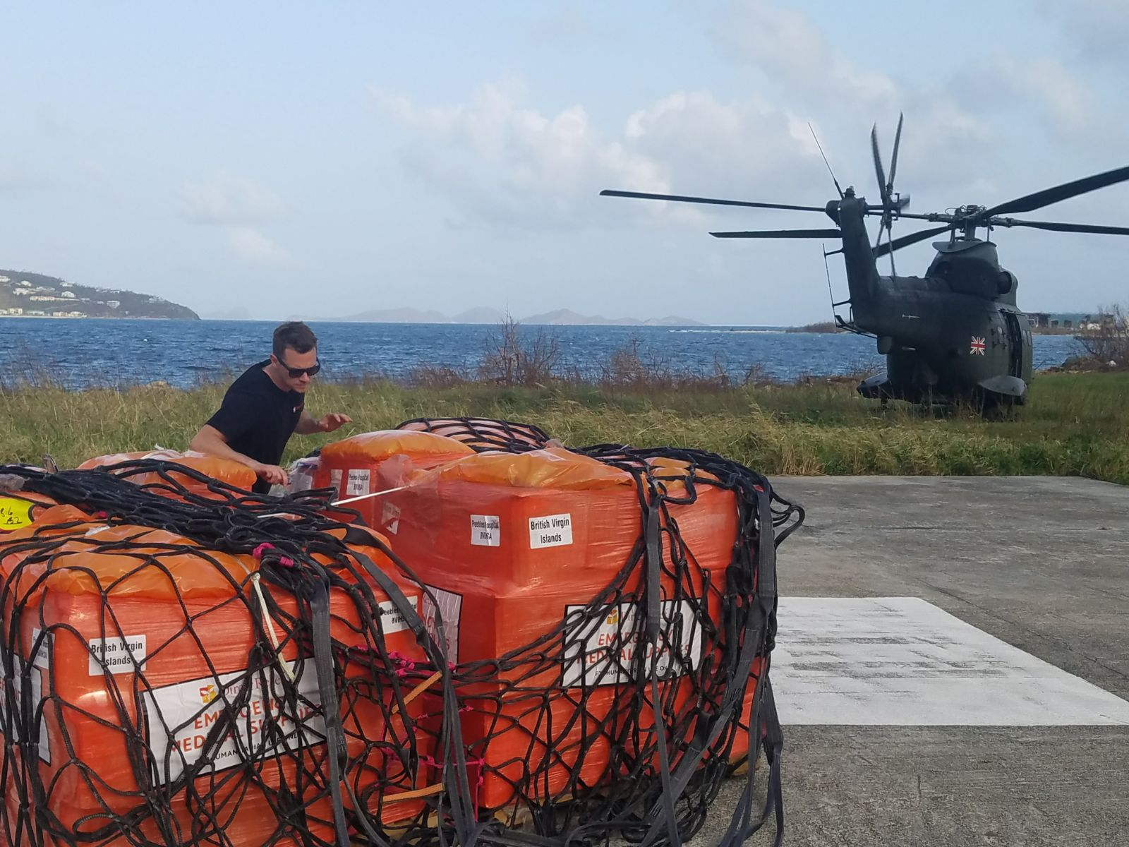 Medicines are delivered to Peebles Hospital in Tortola after being transported by the British Royal Navy. (Andrew MacCalla/Direct Relief)