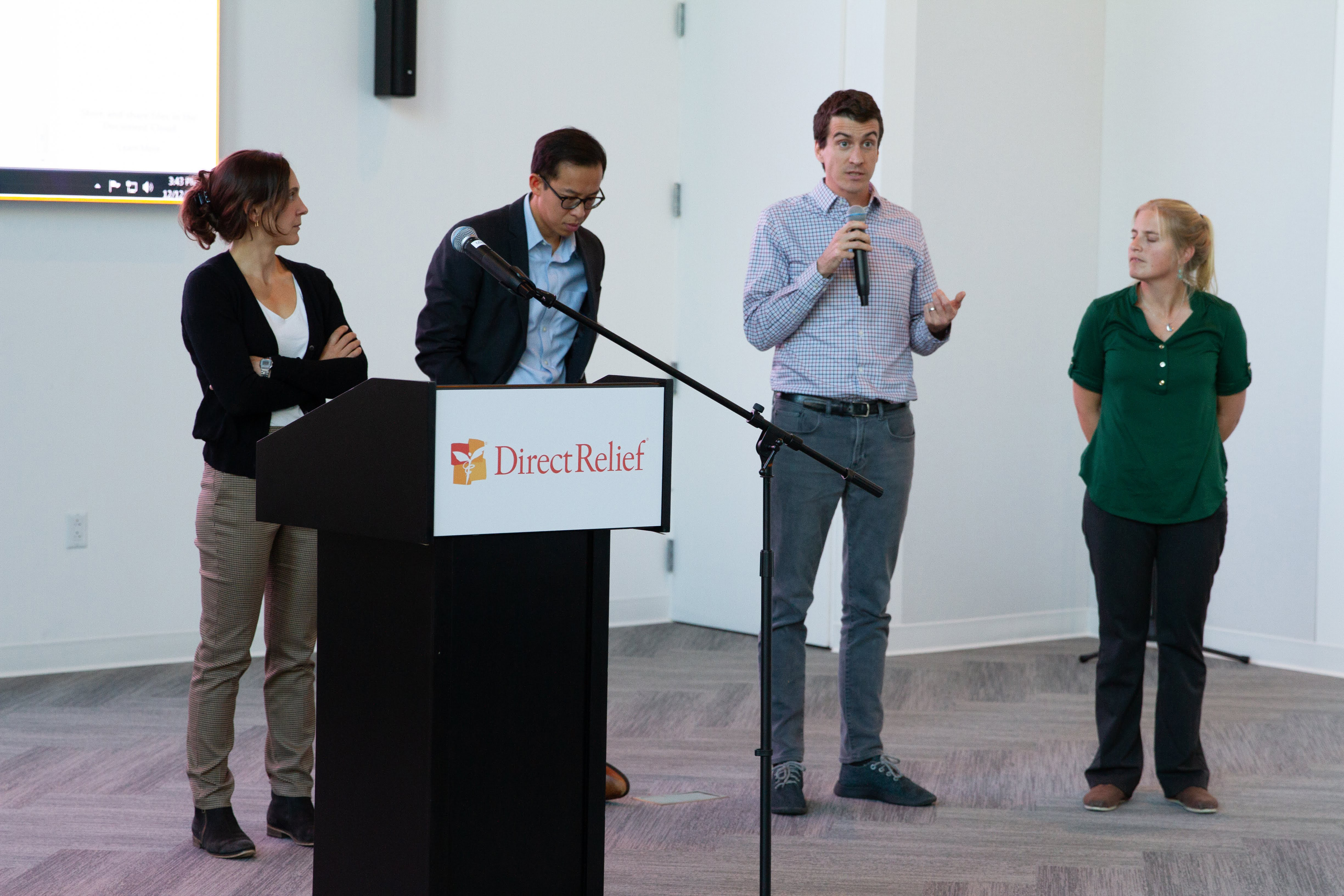 Dr. Mark Buntaine of UCSB's Bren School of Environmental Science and Management, speaks at Direct Relief on Dec. 12, 2018. Buntaine and Drs. Kelsey Jack, Ashley Larsen and Kyle Meng spoke about the effect of climate and disaster response. (Lara Cooper/Direct Relief)