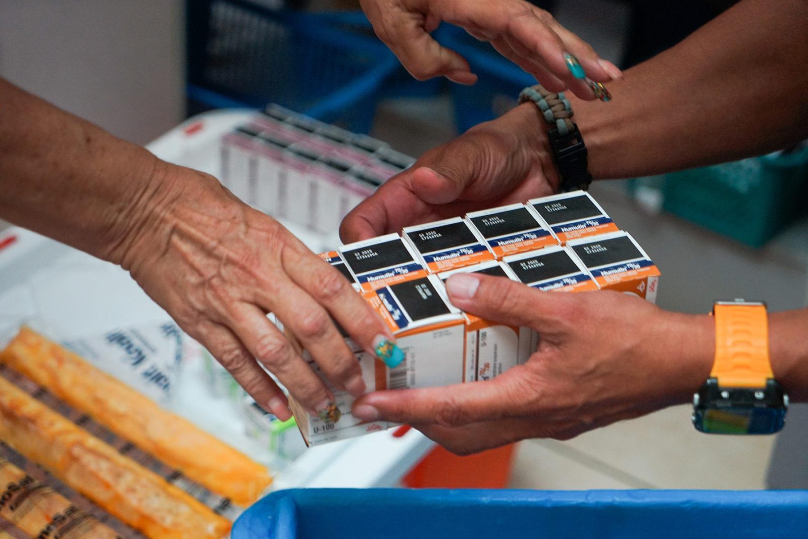 Florida Medical Center staff inventory delivered insulin Friday. (Lara Cooper/Direct Relief)