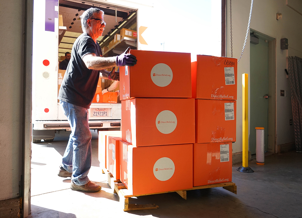 Direct Relief staff load shipments, including emergency medicines and supplies bound for San Juan, Puerto Rico, into a FedEx vehicle Tuesday. (Lara Cooper/Direct Relief photo)