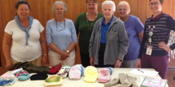 Local Knitting Group Gives Babies Loving Warmth